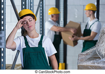 Tired woman - Young tired woman working in warehouse