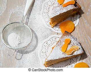 Two pieces of apricot pie on the wooden surface - Two pieces...