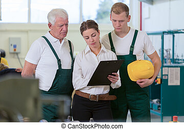 Warehouse workers and supervisor - Two male warehouse...