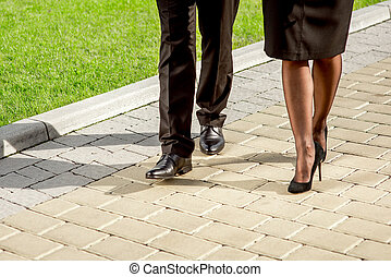 Young Business couple outdoors. - Legs of business couple on...
