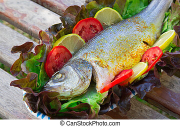 Baked sea bass with vegetables - Baked sea bass Served with...