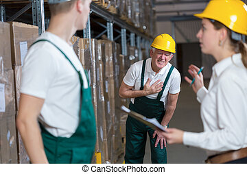 Warehouseman having infarction - Older warehouseman having a...