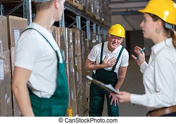 Warehouseman having infarction - Older warehouseman having a...