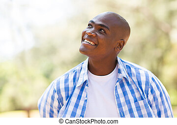 young african man looking up