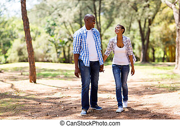 african couple enjoying a walk - happy african couple...