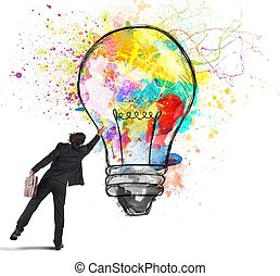 Colors a lightbulb - Businessman color with a spray a...