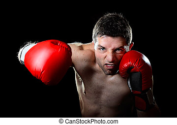 aggressive boxer man boxing in fighting gloves throwing...