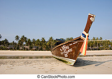 Traditional Thai boat on tropical beach