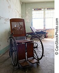 Wheelchair - Empty wheelchair in abandoned antique...