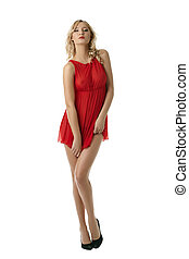 Charming blonde posing in sexy dress, isolated on white