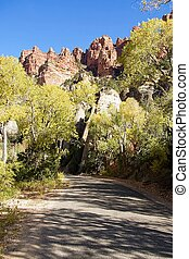 Road to Yankee Meadow - Rural road with sandstone towers and...