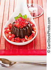 Chocolate pudding with strawberries in white plat on wooden...