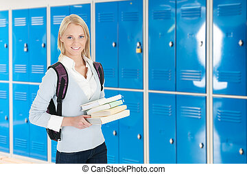 Young Female College Student With Stack Of Book