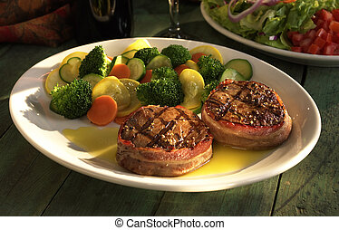 Bacon wrapped Filet mignon with vegetables