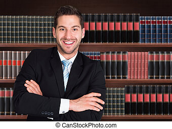 Portrait Of Happy Male Lawyer In Front Of Book Shelf