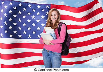 American Female Student - Young Female Student Holding Books...