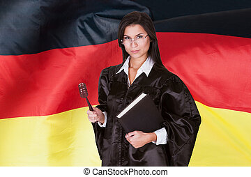 Confident Female Judge With Book And A Wooden Gavel -...