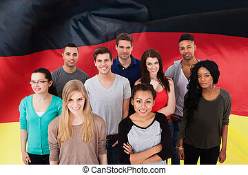 German Classes - Happy Multi-ethnic Group Of People Standing...