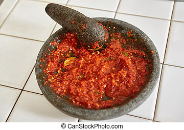 Sambal, special spicy chilli paste in Indonesia, making on...