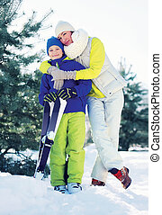 Family healthy lifestyle Mother and son skiing in the...