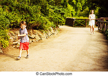 Little boy with his mother - Smiling little boy is walking...