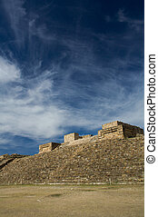 Monte Alban Oaxaca Mexico pyramid slope and sky with clouds