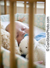 Baby sound asleep in crib - Seven month old baby sound...