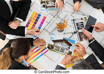 Businesspeople With Color Samples - Group Of Multiethnic...