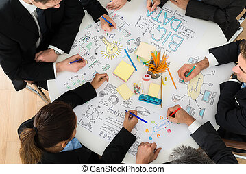 Businesspeople Discussing At Meeting - Group Of...