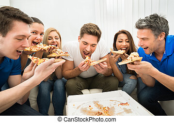 Friends Eating Pizza - Group Of Multiethnic Friends Eating...