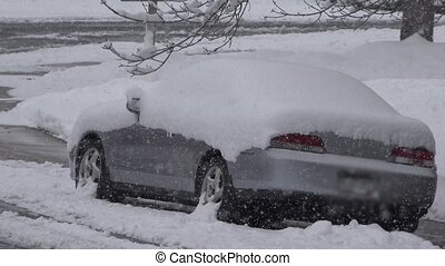 Car Stuck in Snow - A car totally covered in snow while...