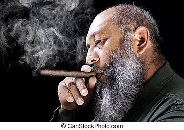 Man smoking cigar - Stock image of adult male with long...