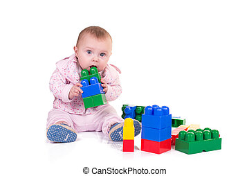 child boy playing with block toys over white background