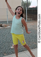 Girl Posing for Camera, Cyprus - Animated girl of 9 pulling...