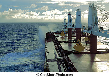deck bulk carrier - ship deck with red sails on the blue sea