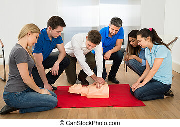Resuscitation Training - First Aid Instructor Showing...