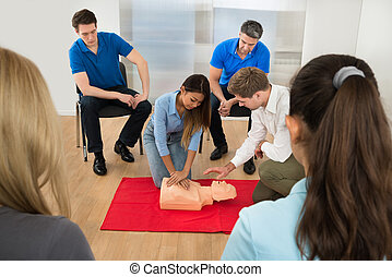 First Aid Training - Instructor Demonstrating Cpr Chest...