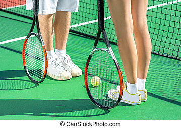 Tennis rackets - Players holding tennis rackets at th tennis...