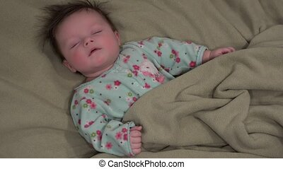 Baby Startles in Sleep - Baby startles in sleep, but goes...