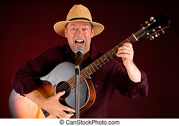 Singing and Playing Acoustic Guitar - A man is playing...