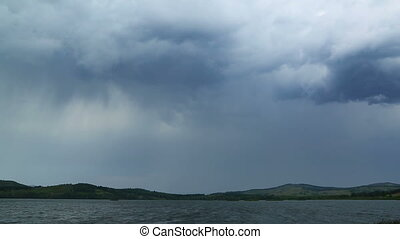 approaching storm - storm clouds over lake - timelapse