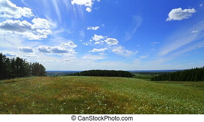 timelapse landscape with clouds moving over summer meadow