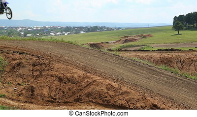 motocross competition on a hilly road