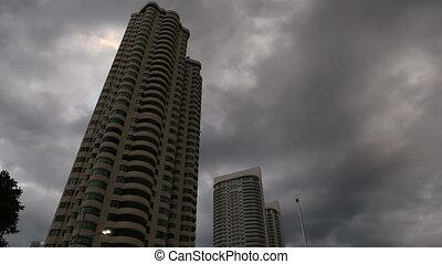 dark clouds over skyscrapers