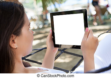 Woman Using Digital Tablet At Beach