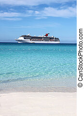 Tropical ship and beach - Looking at a cruise ship in the...