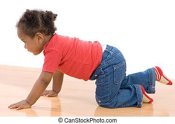 Adorable african baby crawl over wooden floor
