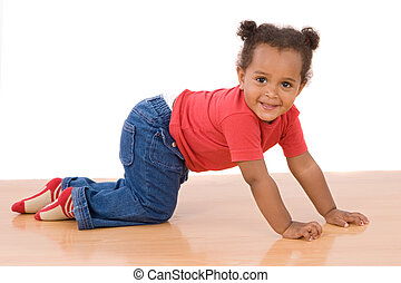 Adorable african baby crawl over wooden floor