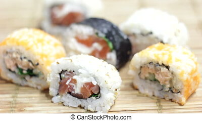 Eating Sushi Maki Rolls - Eating Japanese traditional sushi...