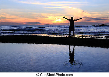 Male silhouette at sunset. - Silhouette of a man with...